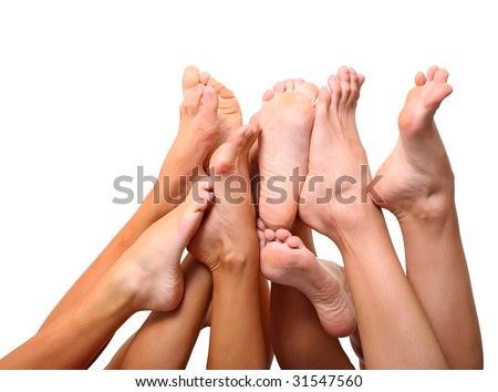 Beautiful graceful female feet, isolated on a white background, please see some of my other parts of a body images - stock photo