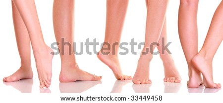 Beautiful graceful female feet, isolated on a white background, please see some of my other parts of a body image - stock photo