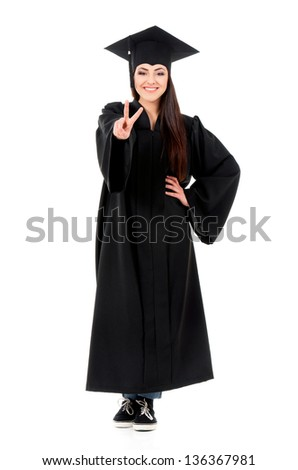 Beautiful graduate girl student in mantle showing victory sign, isolated on white background