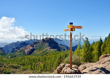Beautiful Gran Canaria  landscape. Pointer to Roque Nublo (rock in clouds) is Symbol of the island Gran Canaria, an ancient and sacred place of worship and main tourist attraction Canary island, Spain - stock photo