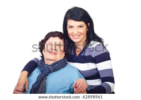 Beautiful granddaughter giving a hug to her grandma isolated on white background - stock photo