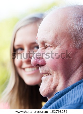 Beautiful granddaughter visiting her grandfather, being happy. - stock photo