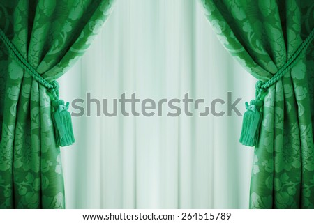 beautiful green curtains with tassels and tulle