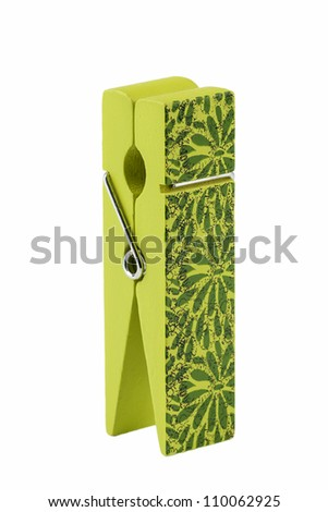 beautiful green decorated wooden clip/peg for remembering messages, holding your business cards or keeping your papers together. Isolated on white background.