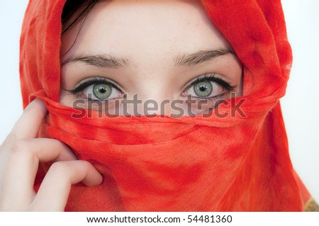 Beautiful Green Eyes and red cover - stock photo