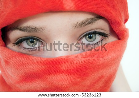 Beautiful Green Eyes with red cover face - stock photo