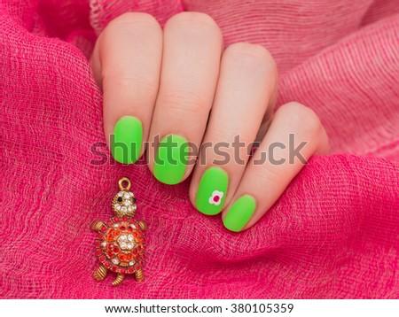 beautiful green female manicure. nails - stock photo