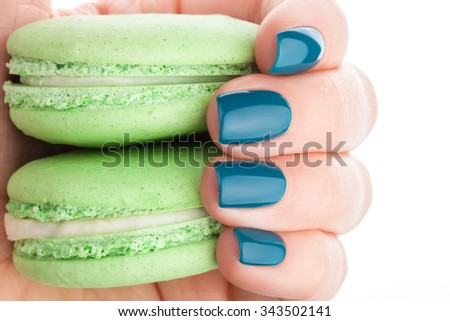 Beautiful green fingernails and a green cake. - stock photo