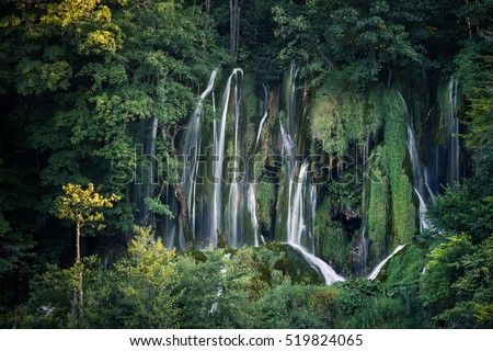 Beautiful green forest waterfall. Plitvice National Park, Croatia.