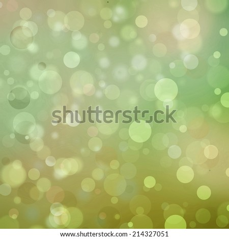 Beautiful green gold bokeh background with shimmering colors and white lights Festive party background. Fantasy night or magical glitter background sparkles