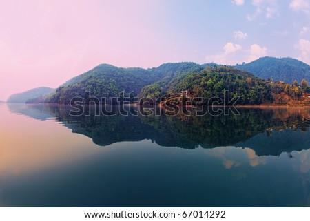 Beautiful green hills landscape from boat view on Phewa lake, Pokhara, Nepal - stock photo