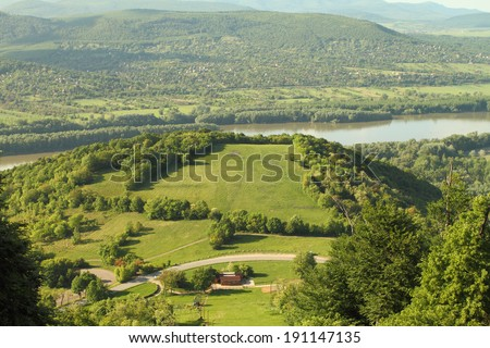 Beautiful green landscape of a river and a hill