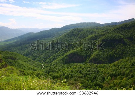 Beautiful green mountain landscape with trees - stock photo