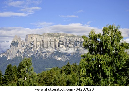 Beautiful green mountain landscape with trees in Renon, Italy, South Tyrol - stock photo