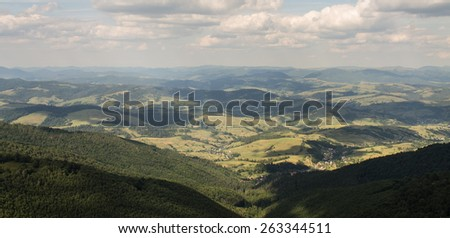 beautiful green mountains hills and cloudy blue sky - stock photo