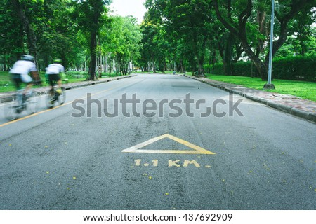 Beautiful green natural garden with bicycle sign bike lane in the park.