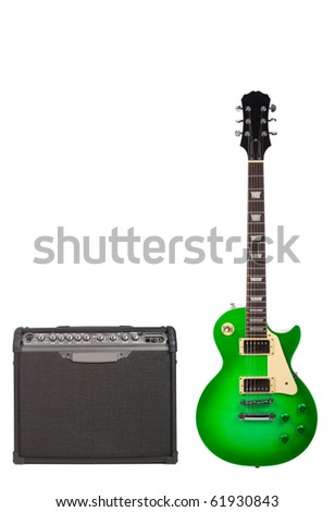 Beautiful green sunburst electric guitar and amplifier isolated on white background - stock photo