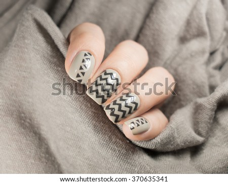 Beautiful grey manicure on hands of the girl - stock photo