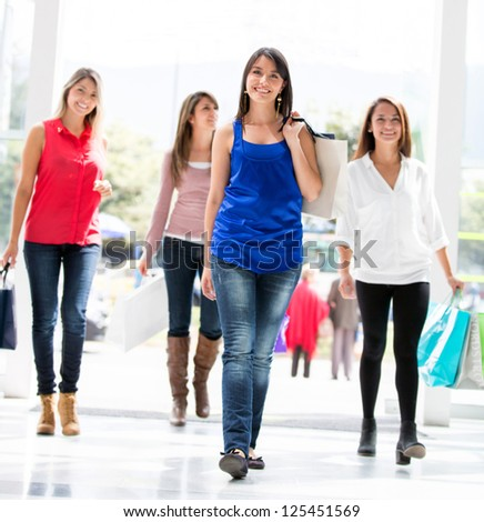 Beautiful group of shopping women walking at the mall - stock photo