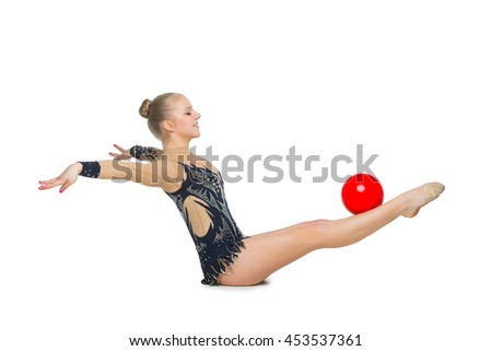 Beautiful gymnast girl with red ball - stock photo