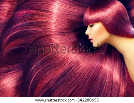 Beautiful Hair. Beauty woman with luxurious long red hair as background. Beauty Model girl with Healthy Hair. Beautiful woman with long smooth shiny straight hair. Hairstyle. Hair cosmetics, haircare - stock photo