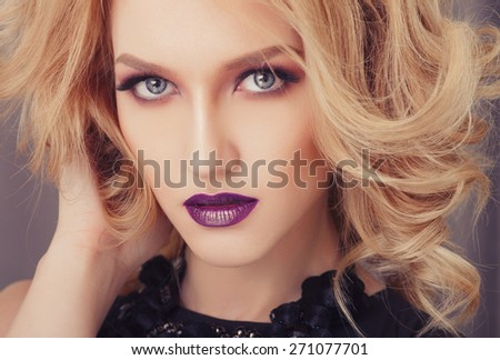 Beautiful hair, portrait of an young girl with beautiful make-up and  plum lips