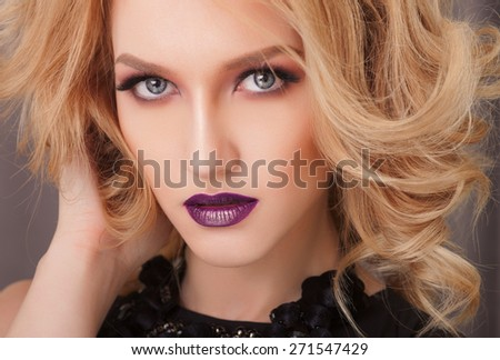 Beautiful hair, portrait of an young girl with beautiful make-up and  plum lips - stock photo