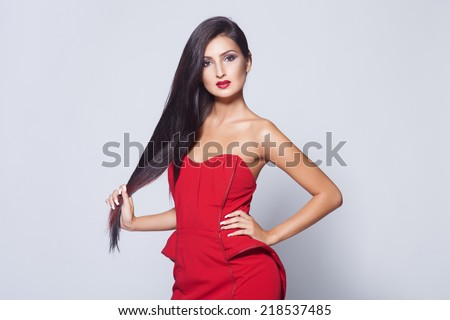 Beautiful hair, portrait of sexy woman in red dress - stock photo