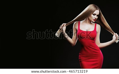 Beautiful hair, portrait of sexy woman in red dress, Attractive blonde model with long straight healthy and shiny hair. High quality image. Hairstyle loose hair.Isolated on black background