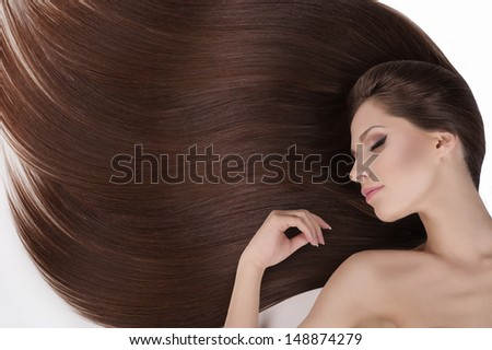 Beautiful hair. Top view of young naked women with beautiful hair keeping her eyes closed while isolated on white - stock photo