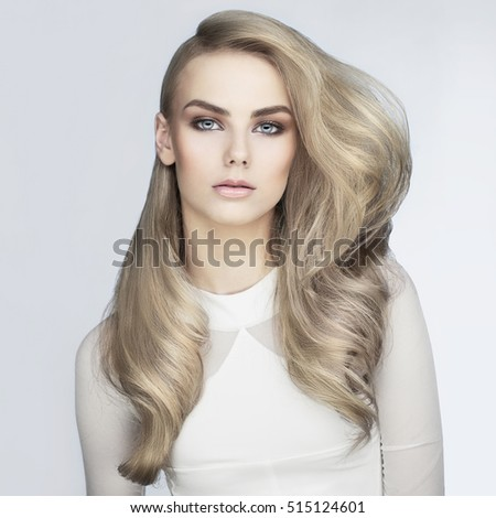 Beautiful haircut. Sexy woman with long hairs. Professional haircut. Beautiful woman with professional hairdo. Blonde fashionable haircut. Professional makeup. Woman with long beautiful blond hairs.