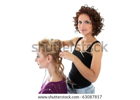 beautiful hairdresser with client isolated over white - stock photo