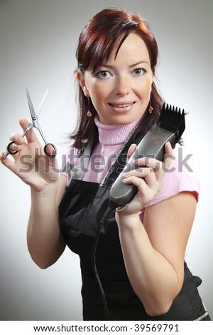 Beautiful hairdresser with scissors - stock photo