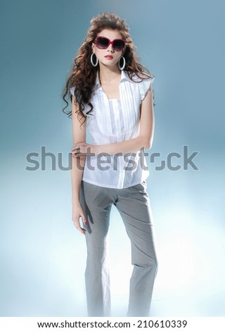Beautiful hairstyle girl on light background/ Studio shot  - stock photo
