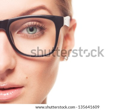 Beautiful half face woman in glasess looks into the camera isolated on white background