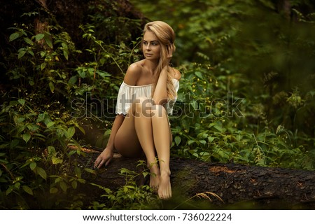 naked-naked-woman-in-the-woods-sucking