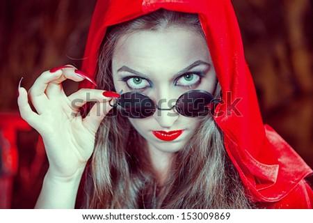 Beautiful halloween woman in black glasses  - stock photo