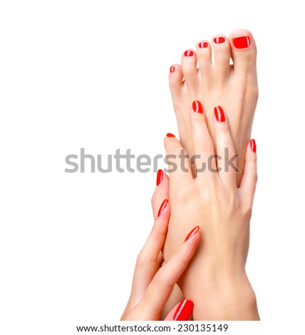 Beautiful hand and foot with red shiny manicure and pedicure, shellac. Concept of spa. Over white background with copy space.  - stock photo