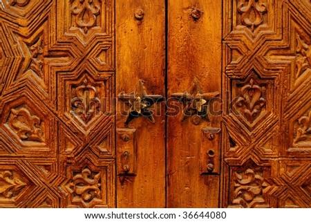 Beautiful hand carved wooden door in Marrakech, Morocco - stock photo