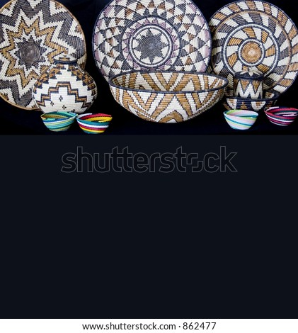 Beautiful Hand crafted baskets and bowls with copy space - stock photo
