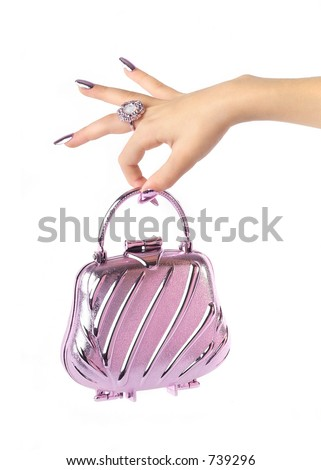 beautiful hand holding evening handbag