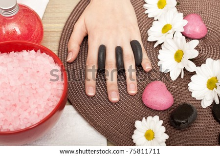 beautiful hand on spa treatment with rock - stock photo