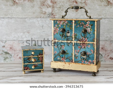 Beautiful handmade decoupaged jewellery boxes on a rustic background - stock photo