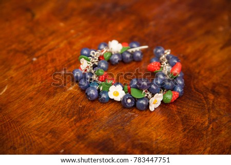 Beautiful handmade fimo clay bracelet on wooden background