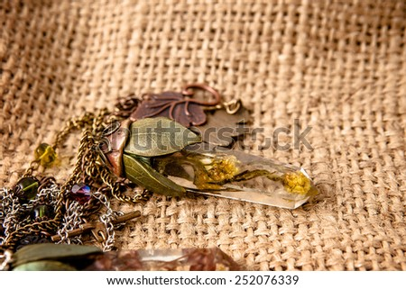 Beautiful handmade pendant with flowers in resin  - stock photo