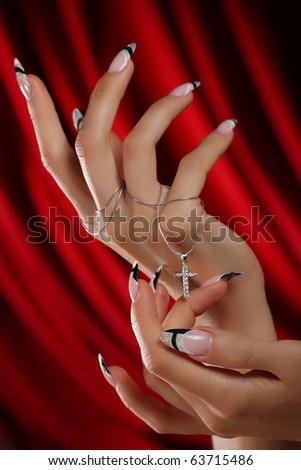 beautiful hands and nails on a red background - stock photo