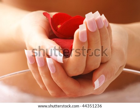 beautiful hands in bath - stock photo