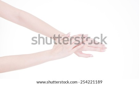Beautiful hands of young woman, hand touching another hand - stock photo
