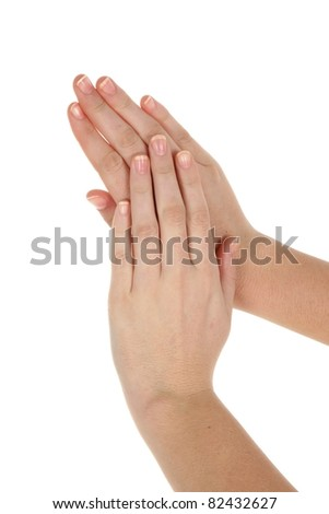 Beautiful hands of young woman isolated on white background