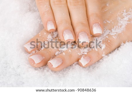 beautiful hands with snow closeup - stock photo